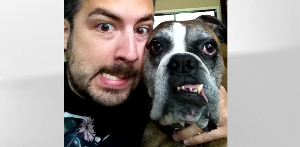 PHOTO: Justin Miller, 33, of Raleigh, N.C., poses with his boxer-bulldog mutt, Stella.