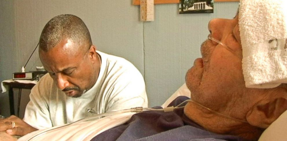 PHOTO: A prison volunteer prays with dying Jack Hall in Iowa State Penitentiarys hospice program.