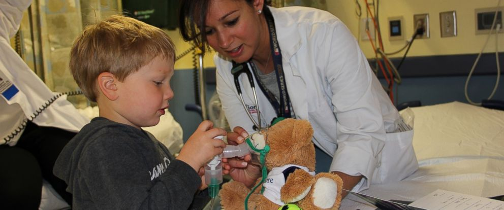 Three-year-old Sean Polidoro administers oxygen to his sick teddy bear.PHOTO: