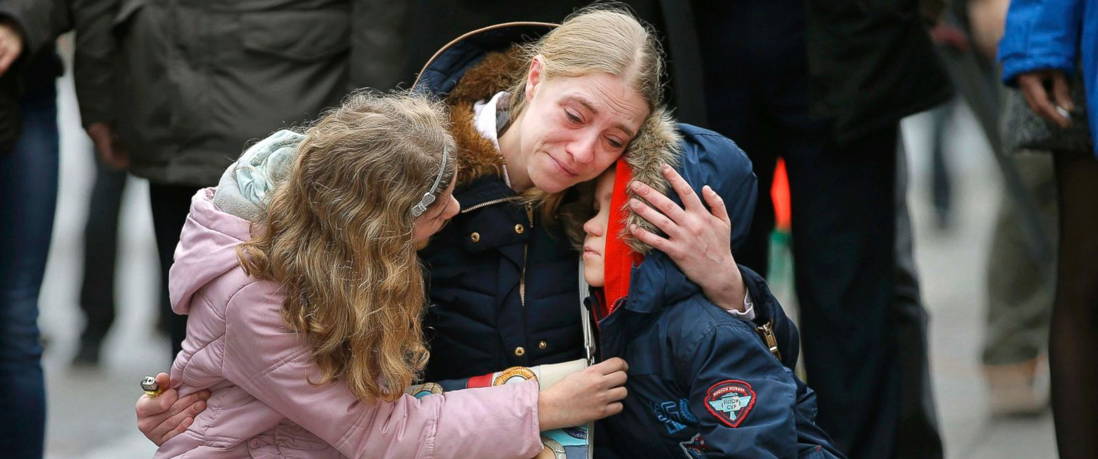 PHOTO: A woman consoles her children at a street memorial following Tuesdays bomb attacks in Brussels on March 23, 2016.