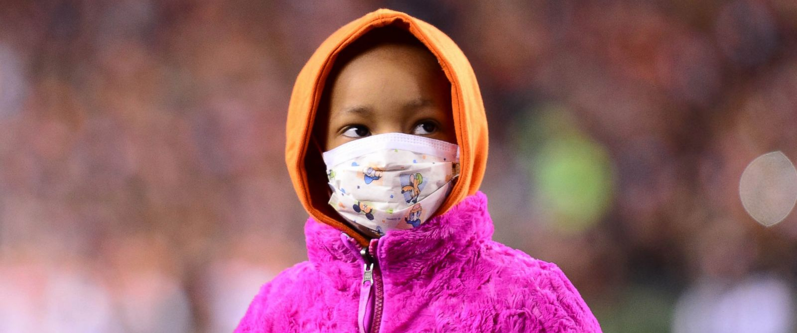 PHOTO: Leah Still daughter of Cincinnati Bengals defensive tackle Devon Still stands on the field during the first quarter against the Cleveland Browns at Paul Brown Stadium, Nov. 6, 2014.