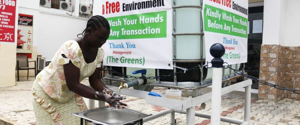 PHOTO: A woman washes her hands at a tap provided by the Green Pharmacy, Area 8, Abuja, Nigeria