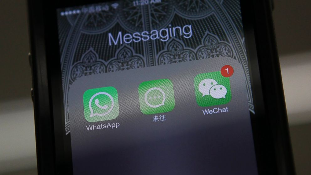 PHOTO: Icons of messaging applications WhatsApp of Facebook, Laiwang of Alibaba Group and WeChat, or Weixin, of Tencent Group, are seen on the screen of a smart phone on this photo illustration taken in Beijing, Feb. 24, 2014.
