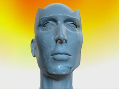 VIDEO: A computer image of a face without skin.