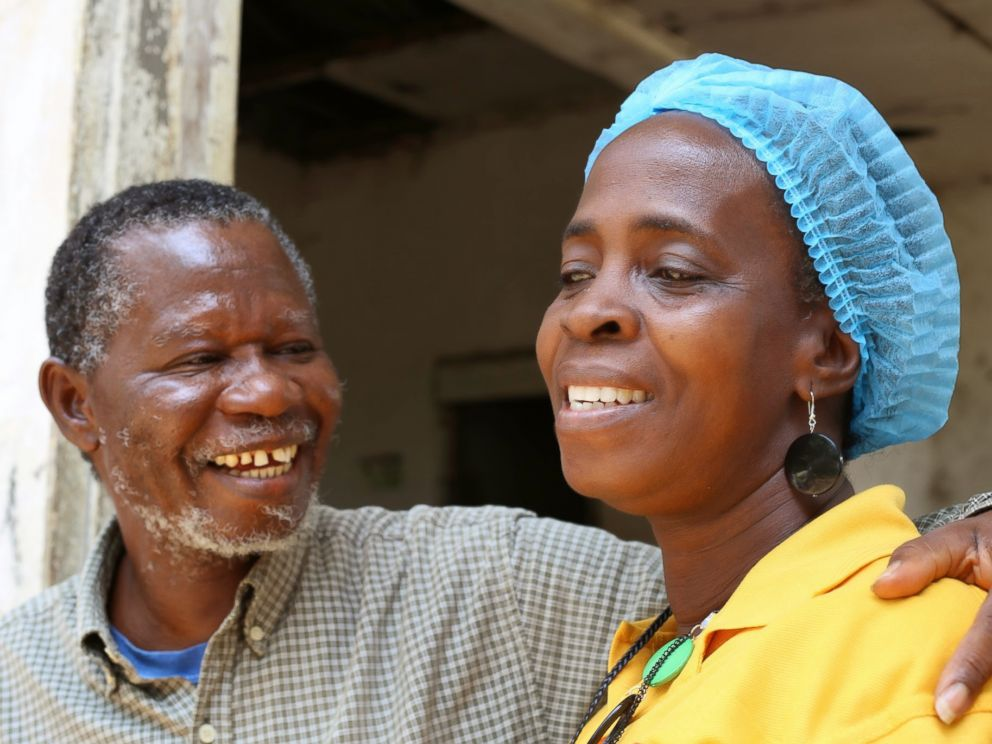 PHOTO: Beatrice Yardolo receives a hug from her husband, Steve Yardolo Sr., on the day of her release from a Chinese Ebola treatment unit in Monrovia, Liberia on March 5, 2015.