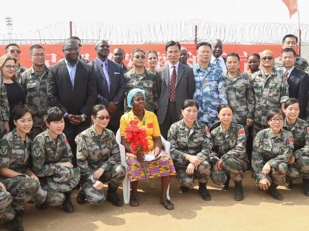 PHOTO: Beatrice Yardolo poses for a photo with Chinese soldiers and officials from the Liberian government, Chinese embassy, and WHO on the day of her release from the Chinese Ebola treatment unit in Monrovia, Liberia on March 5, 2015.