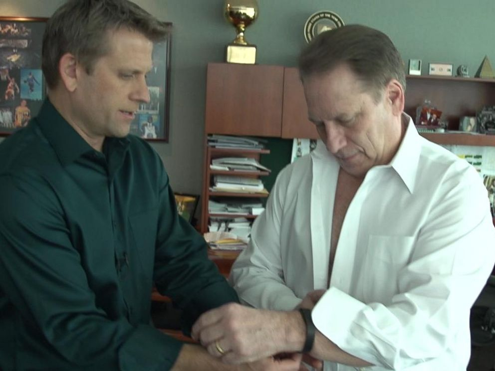 PHOTO: ESPN Sport Sciences John Brenkus (left) talks with Michigan States Tom Izzo (right) as the coach gets wired up for the health experiment.