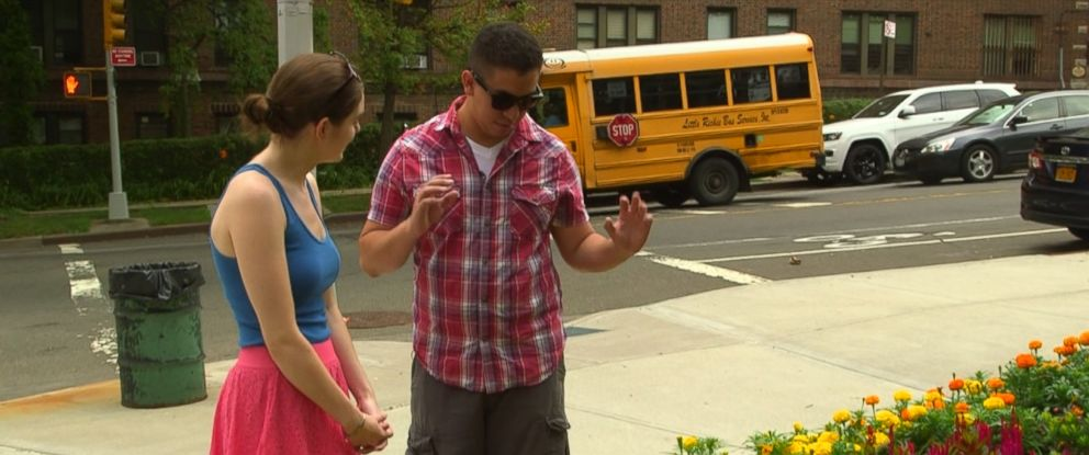 """Oscar Puente tests out the EnChroma glasses with his fiancee for an ABC News """"Nightline"""" report."""