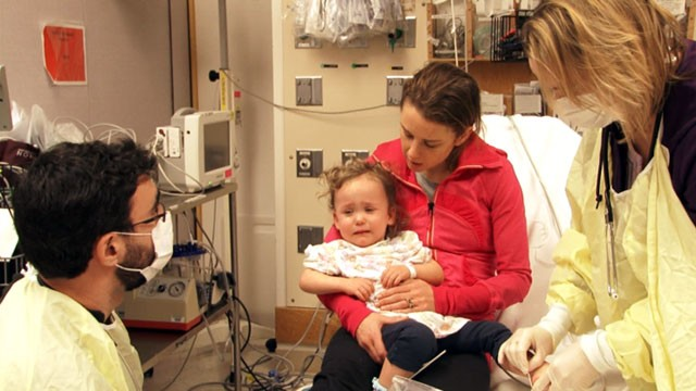 PHOTO:  Little Cassie is treated at Boston's Children's Hospital when her mother brings her in with suspected flu symptoms. She was one of dozens of patients Boston-area hospital treated for flu in the past 48 hours.