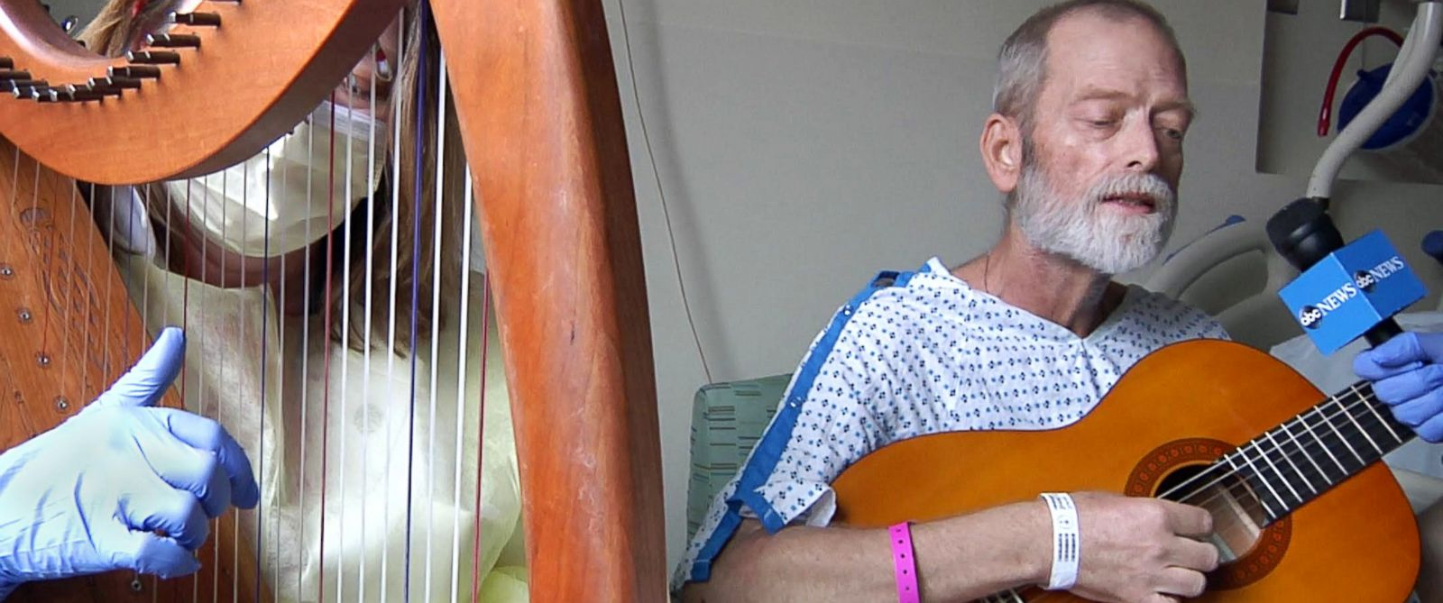 """PHOTO: Patient Garrett Lambert plays """"Dont Let Us Get Sick,"""" accompanied on the harp by Memorial Sloan Kettering Cancer Center music therapist Holly Mentzer."""