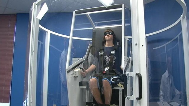 PHOTO: Will Arlen, 17, is strapped into the GyroStim, a machine that Dr. Ted Carrick said helps stimulate parts of the brain that may be damaged.
