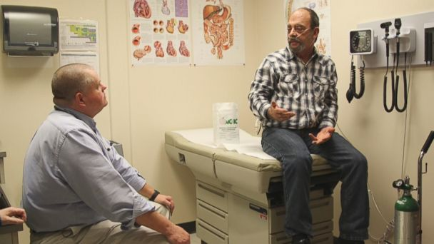 Mike Taylor, a former coal truck driver, (right), is seen here during an appointment with Dr. Van Breeding (left) at Mountain Comprehensive Health Corporation in Whitesburg, Kentucky.