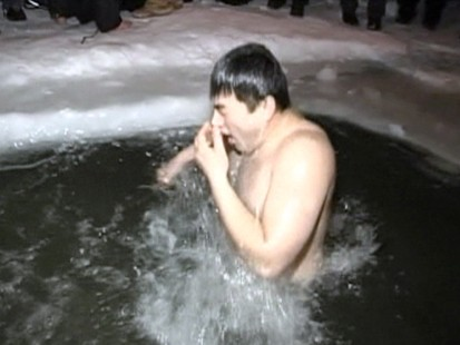 VIDEO: Many Russians dive into frigid waters as part of the Epiphany celebration.