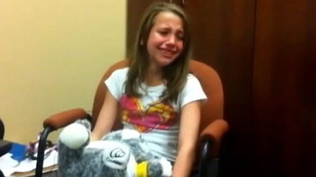 PHOTO: A 10-yr. old deaf girl, Sammie Hicks, reacts to hearing for the first time.