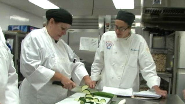 PHOTO: Cook for America co-founder Andrea Martin instructs school cafeteria workers on re-learning the basics of cooking from scratch.