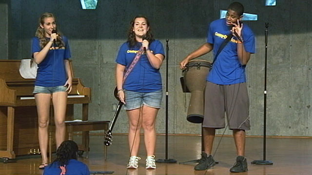 PHOTO: Alina Davis, center, sings a song she co-wrote with her friends at Camp Our Time.