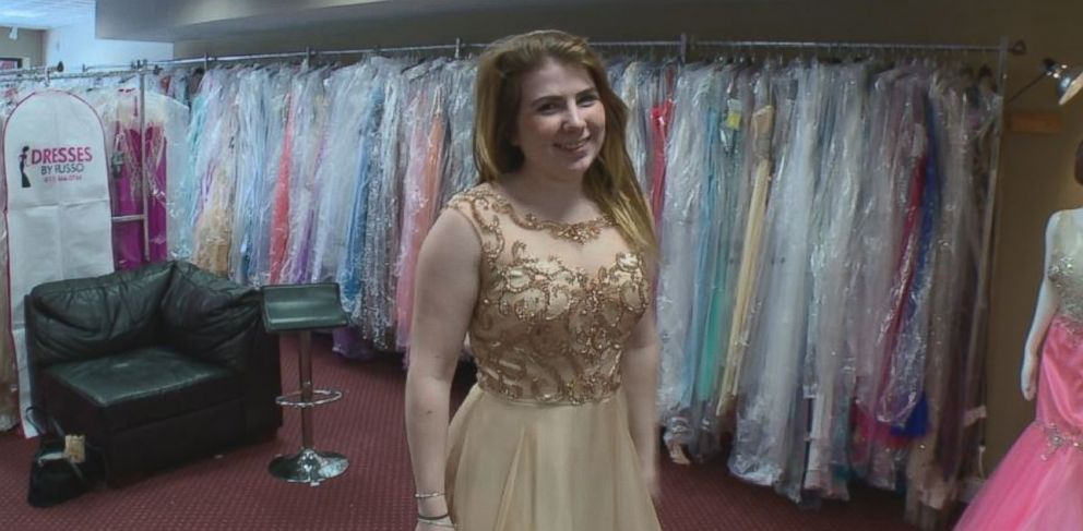 Mackenzie Langan is shown here trying on prom dresses after her surgery.