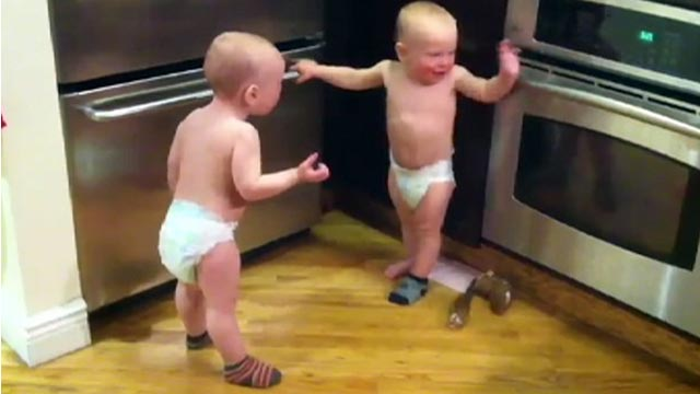 PHOTO:Twin boys have a conversation together in baby talk