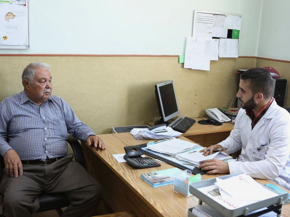 PHOTO: Shawkat al-Khalili, a 70-year-old diabetic, is examined by Dr. Nayef Khalayla at Jordans National Center for Diabetes in Amman, Jordan on June 14, 2015.
