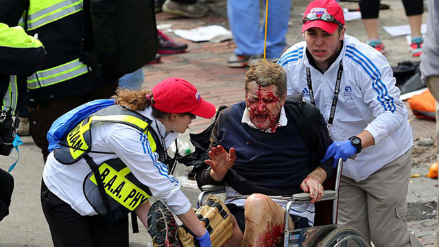PHOTO: Medical workers aid an injured man at the 2013 Boston Marathon following an explosion in Boston, April 15, 2013.