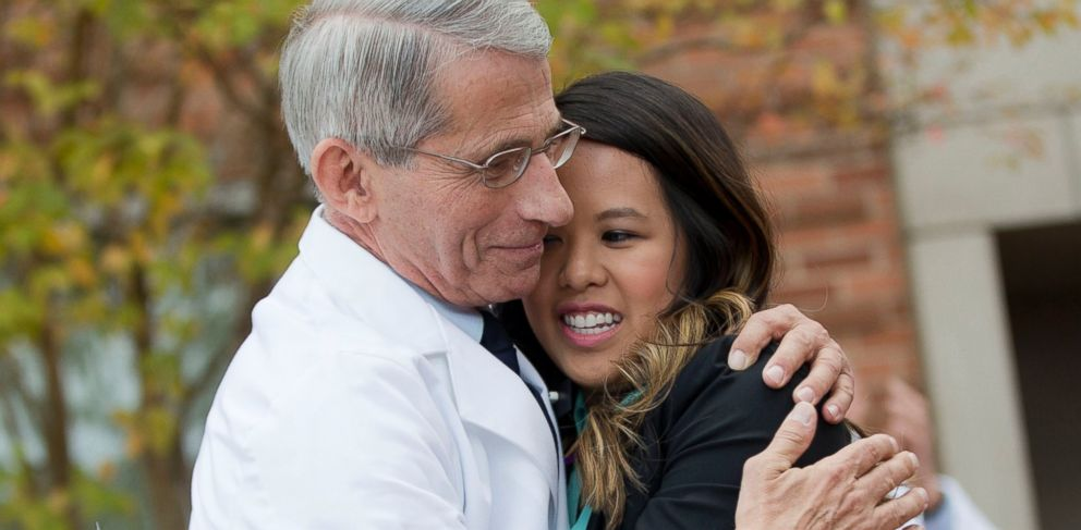 PHOTO: Nina Pham is hugged by Dr. Anthony Fauci, director of the National Institute of Allergy and Infectious Diseases, outside NIH in Bethesda, Md., Oct. 24, 2014.