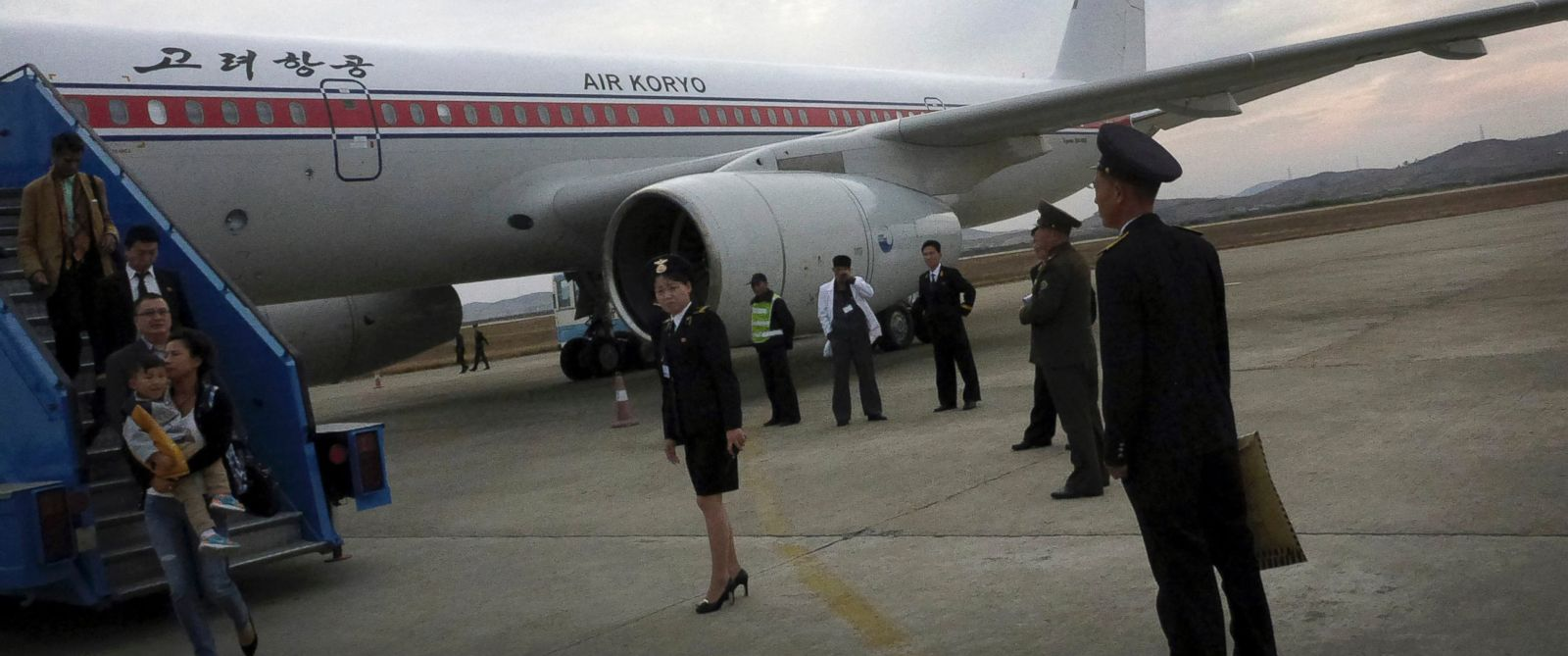 PHOTO: Passengers disembark an Air Koryo flight in Pyongyang, North Korea on Oct. 21, 2014.