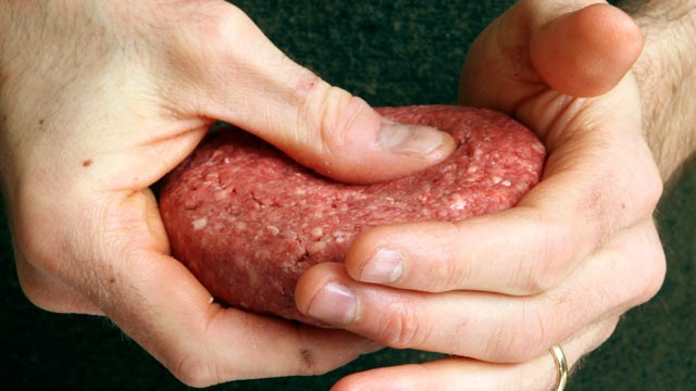 "PHOTO: A hamburger is made from ground beef containing what is derisively referred to as ""pink slime,"" or what the meat industry calls ""lean, finely textured beef,"" on March 15, 2012 in Concord, N.H."