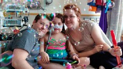 Sarah Murnaghan, center, celebrates the 100th day of her stay in Children's Hospital of Philadelphia with her father, Fran, left, and mother, Janet, in this May 30, 2013 photo.