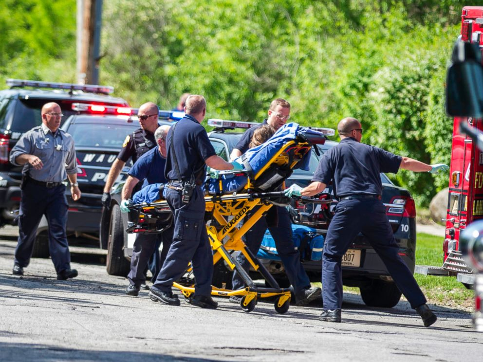 PHOTO: Rescue workers take a 12-year-old stabbing victim to an ambulance in Waukesha, Wis. after she was attacked by two 12-year-old-friends who claim they were inspired by a story they read online.