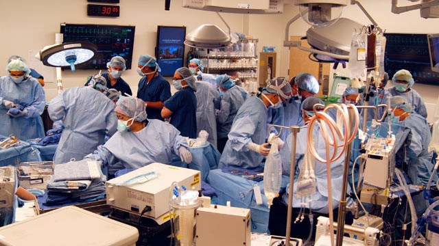 PHOTO: A surgical team at Johns Hopkins Hospital in Baltimore works on a double arm transplant for U.S. Army infantryman Brendan Marroco, 26, who lost all four limbs in Iraq, Dec. 18, 2012.