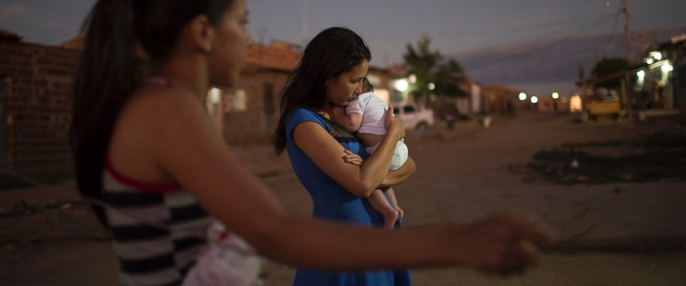 PHOTO: Milena Kaline, 17, who is three months pregnant, holds Angelica Pereiras daughter Luiza, who was born with microcephaly, as they talk in Santa Cruz do Capibaribe, Brazil, Feb. 6, 2016.
