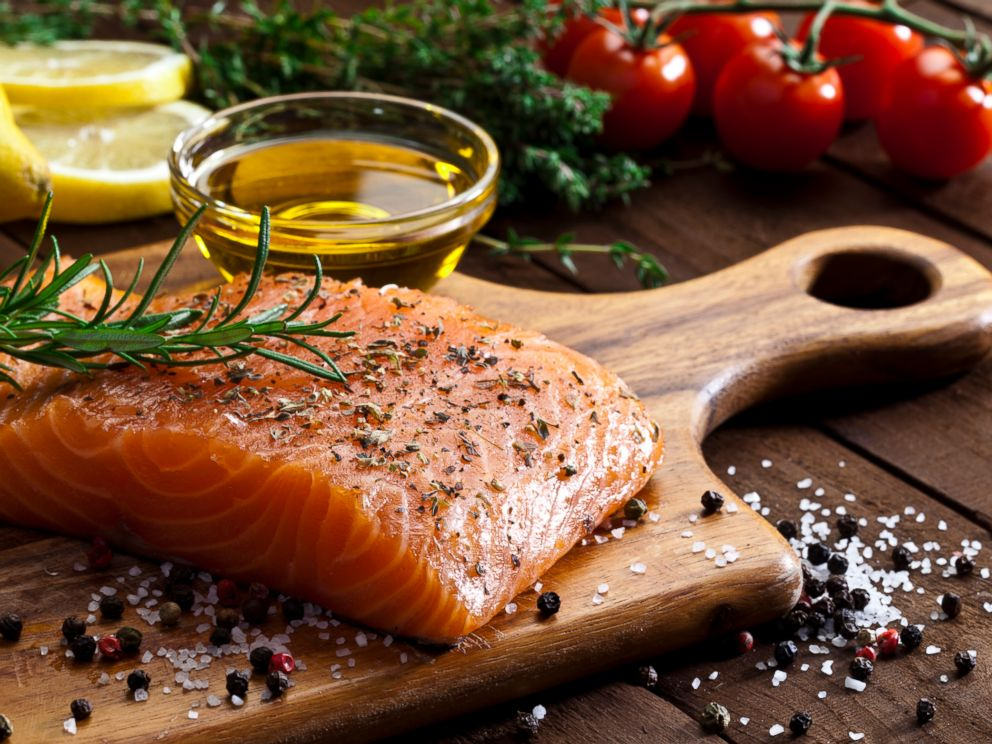 PHOTO: A salmon steak and olive oil are being prepared for cooking in this stock image.