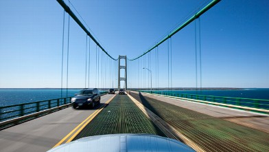 Cars cross the Straits of Mackinac as they drive over the Mackinac Bridge in Michigan, May 17, 2009.