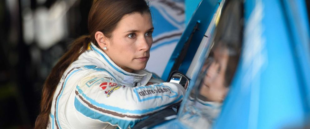 PHOTO: Danica Patrick looks on in the garage after practice for the NASCAR Sprint Cup series auto race, May 14, 2016, at Dover International Speedway in Dover, Del.