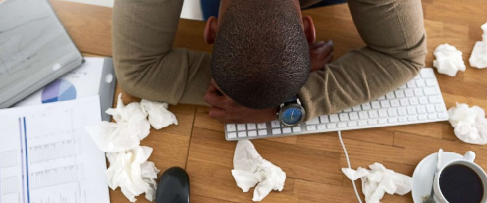 PHOTO: A man lays his head on his desk in this undated stock photo.