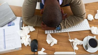 'PHOTO: A man lays his head on his desk in this undated stock photo.' from the web at 'http://a.abcnews.com/images/Health/flu-sneeze-gty-01-jpo-171229_16x9t_384.jpg'