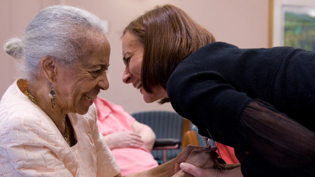 PHOTO: Music therapist Heather Davidson (R) embraces June Thorne after holding a drum circle with patients with Alzheimers disease at the Copper Ridge Care Center in Sykesville, Maryland, on October 23, 2009.