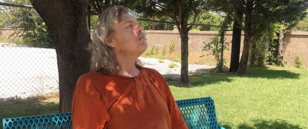 PHOTO: Greg Todd, 60, a resident of the Westchester Plaza, the largest assisted-living facility for Medicaid recipients in Texas, sits on a bench at the plaza, July 14, 2017, in Fort Worth, Texas.