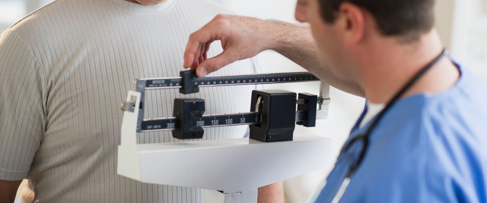 PHOTO: A man is weighed by a doctor in an undated stock photo.