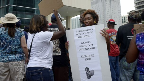 PHOTO: Monique Messer holds her sign, which she says sums up her feelings about Florida 'Stand Your Ground' laws, during a 'Justice for Trayvon' rally at the Wilkie D. Ferguson Federal Courthouse in Miami, Florida, July 20, 2013.
