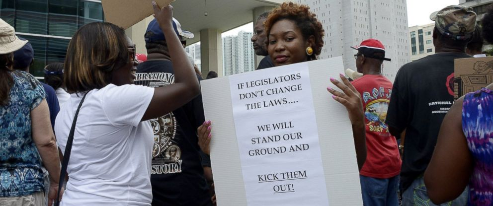PHOTO: Monique Messer holds her sign, which she says sums up her feelings about Florida Stand Your Ground laws, during a Justice for Trayvon rally at the Wilkie D. Ferguson Federal Courthouse in Miami, Florida, July 20, 2013.