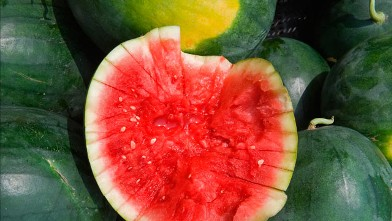 PHOTO: A sliced open watermelon is seen as locally grown fruits and vegetables are sold at the Herndon, Virginia, Farmer's Market July 30, 2009.