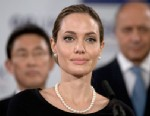 PHOTO: Actress Angelina Jolie, front of G8 foreign ministers, speaks at a G8 Foreign Ministers press conference on sexual violence against women in London, April, 11, 2013 to announce new funding to tackle the issue.