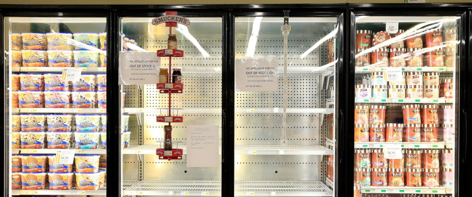 PHOTO: Shelves are bare and signs are posted where Blue Bell products were displayed in a grocery store on April 21, 2015 in Overland Park, Kan.
