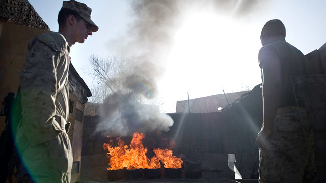 PHOTO: U.S. Marines burn human waste as they clean their lavatories at the Musa Qala District Center base, Jan. 17, 2011.