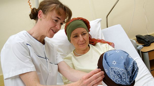 PHOTO: A nurse speaks to a cancer patient.