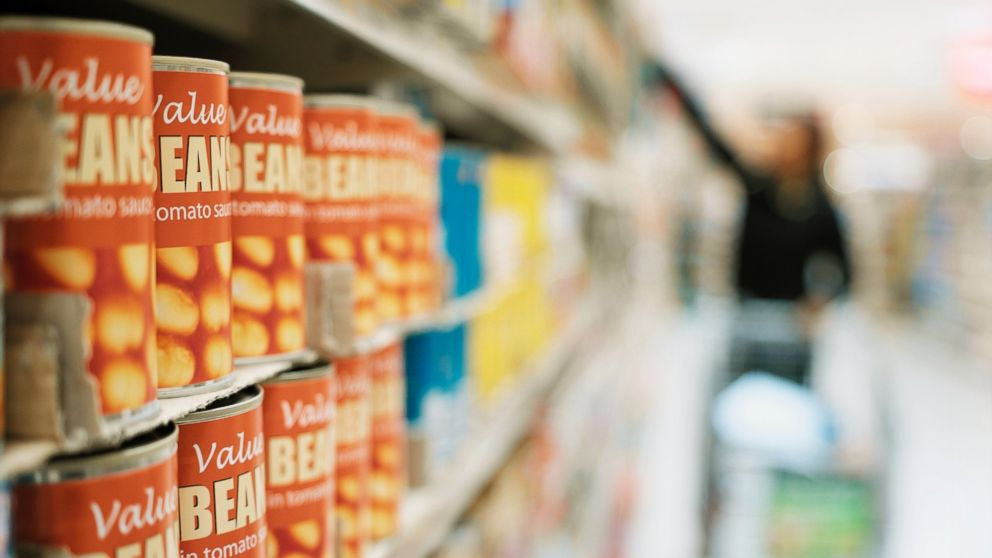 PHOTO: A shopper looks through canned food in a supermarket in an undated stock photo.