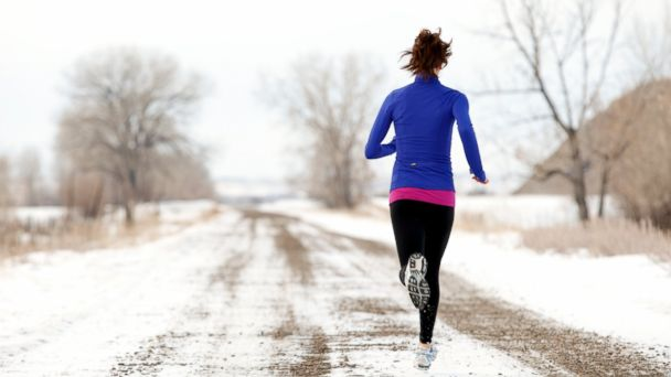 PHOTO: A woman is seen jogging in winter in this stock photo.