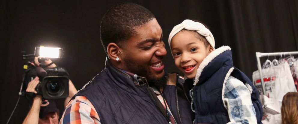 PHOTO: NFL player Devon Still and his daughter Leah attend the Nike Levis Kids fashion show at The Salon at Lincoln Center on Feb. 12, 2015 in New York City.