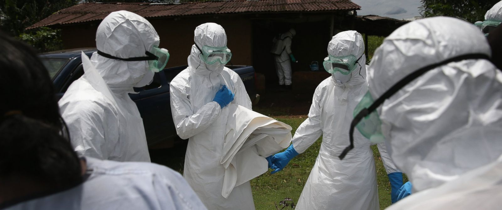 PHOTO: A burial team from the Liberian Red Cross prays before collecting the body of an Ebola victim from his home, Oct. 8, 2014 near Monrovia, Liberia.